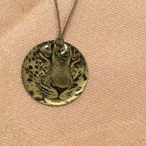 Jewelry - Tiger face disk on gray string